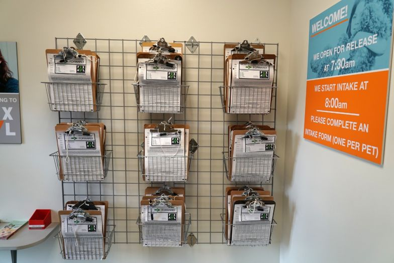 wall of clipboards containing spay neuter documentation