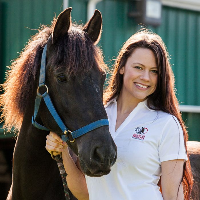 Tinia Creamer outdoors smiling with brown horse